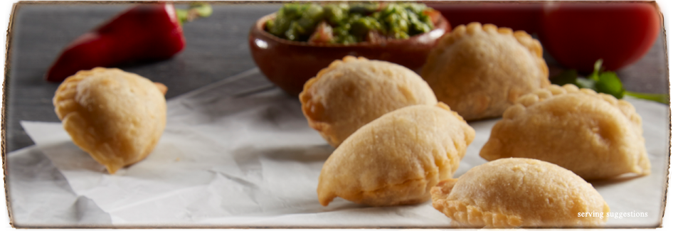 Mexican Food Appetizers with Rolled Tacos and Mini Empanadas by DON MIGUEL®